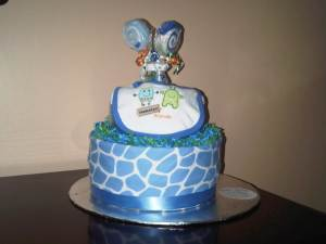 A cake made out of baby items